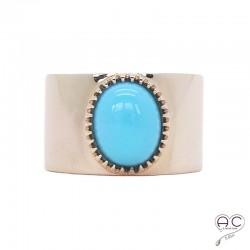 Bague turquoise sertie sur un anneau large ouvert en plaqué or